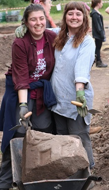 The finders of the medieval grave slab fragment celebrate