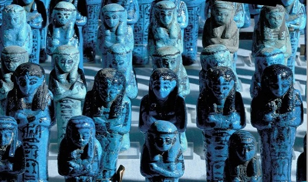 blue and black individual ancient statues. Some statues look Ancient Egyptian in style