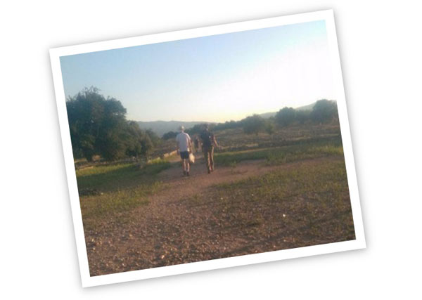 Two people walking through countryside