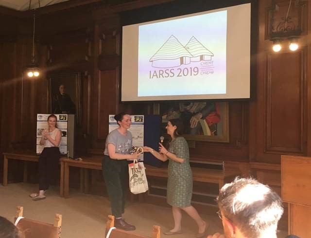 Emily Prtak winning best poster at IARSS 2019