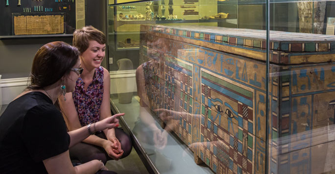 Students looking at Egyptian coffin