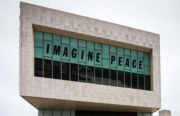Museum of Liverpool with Imagine Peace banner in windows