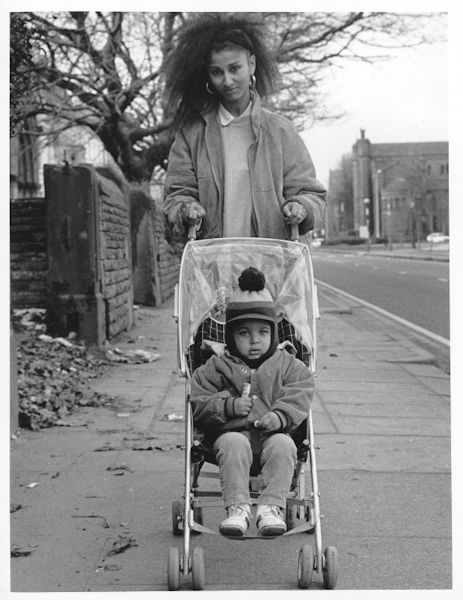 Mother with a child in a buggy.