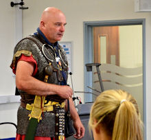 Roman soldier talks to Year 10 pupils at our 2014 Summer Fair