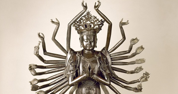Statue of Hindu God with many arms.