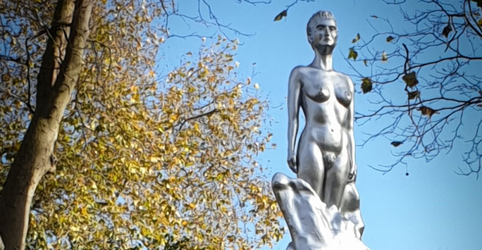 Silver statue of a naked female body