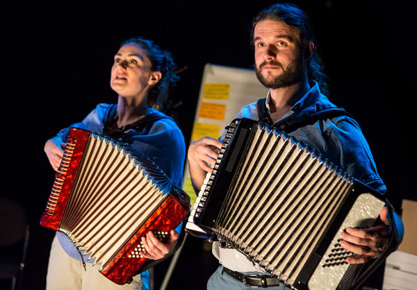 Actors playing accordian