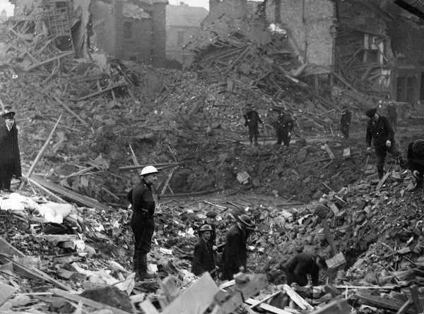 Men scouting a bombed area in Crosby after the May Blitz.