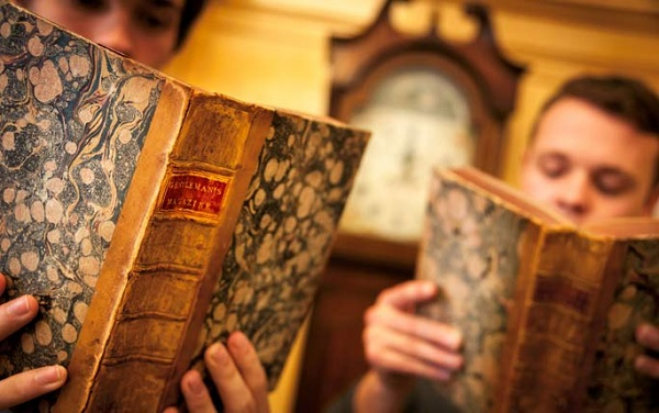 Students looking through book