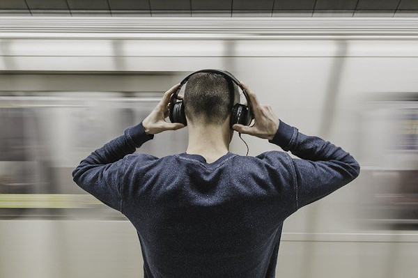Person with headphones in subway
