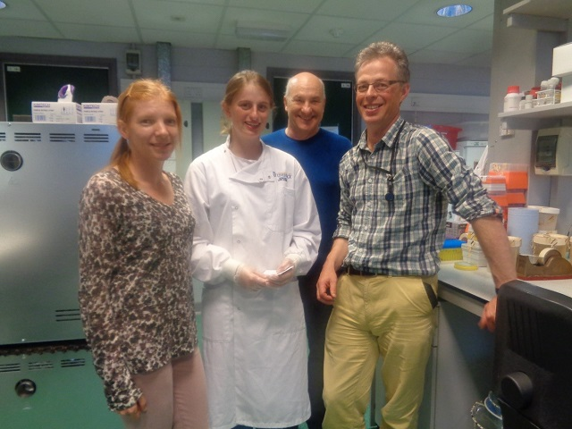 female placement student with research staff in microbiology lab