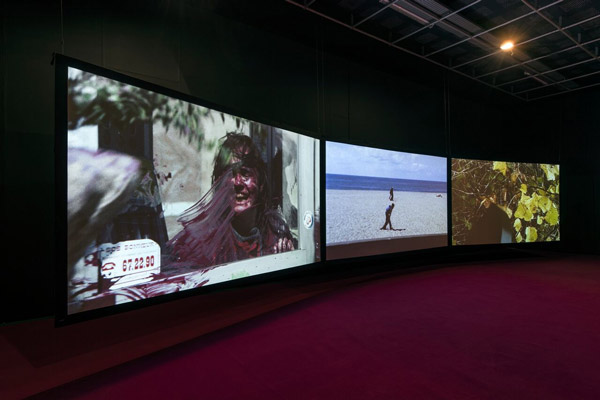 Three screens showing films