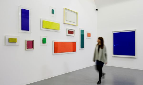 Multi-coloured paintings in a gallery