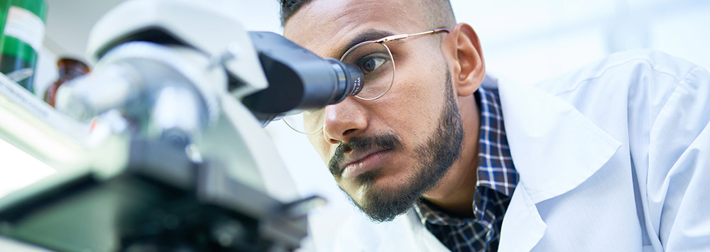 Scientist using a microscope