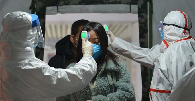 Woman having temperature taken