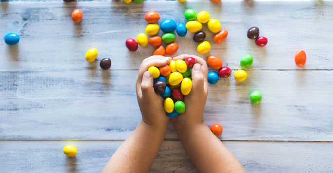 Child's hands full of sweets