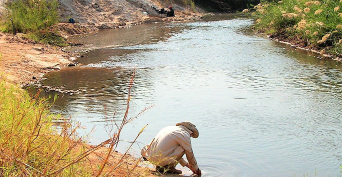 Archaeologist working by a river