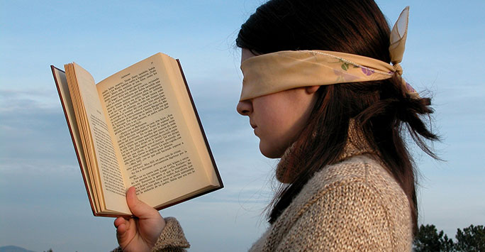 Blindfolded woman and book