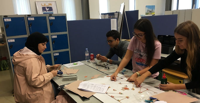 Civil Engineering students building bridges