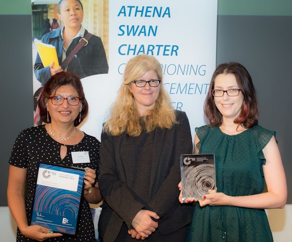 Dr Gita Sedghi (left) and Dr Kamila Zychaluk (right) receiving the Athena SWAN Silver award from Professor Helen Beebee