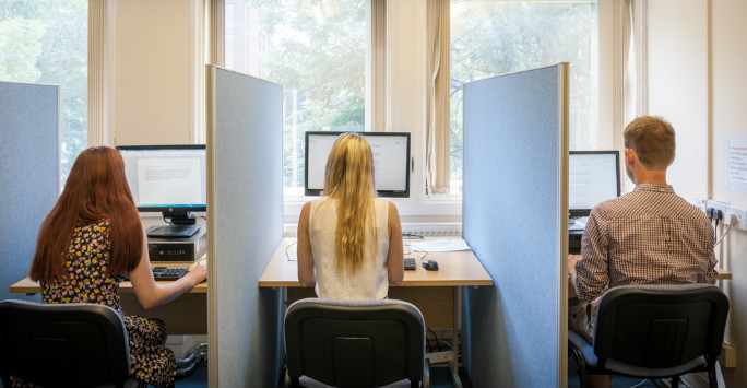 Students at a bank of computers in the School of Psychology