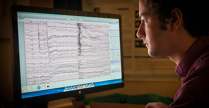 A School of Psychology researcher examines data on a computer screen