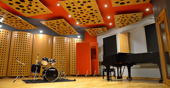 Studio with drum kit and piano at the Department of Music.