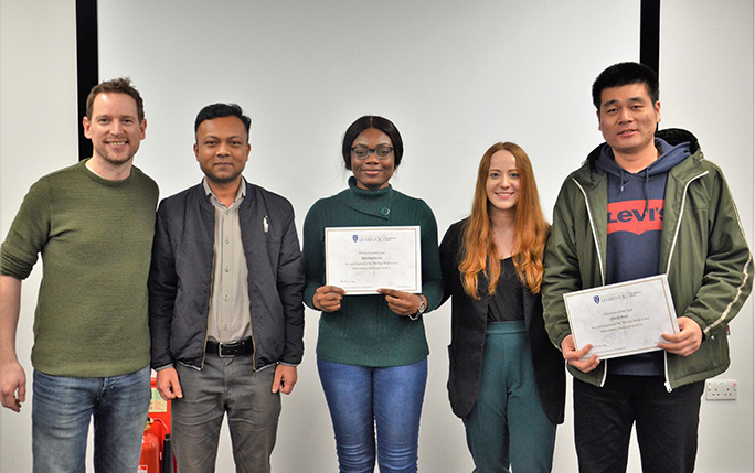 A group of students who have successfully completed the Consultancy challenge. Smiling and holding certificates