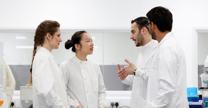 Postgraduate students in lab coats